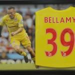 Craig bellamy Framed shirt with background image in a picture frame